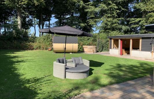 Vakantiehuis Voorthuizen omheinde tuin